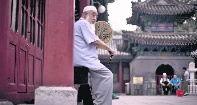 Uyghurs' predicatement between sinification and Chinese securitization in Xinjiang