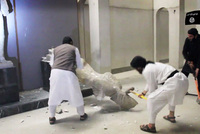 The self-proclaimed Islamic State of Iraq and al-Sham (ISIS) released  a video on Thursday showing militants using  sledgehammers to  smash ancient Assyrian and Akkadian sculptures in the Mosul...