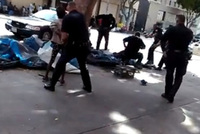 A video posted on Facebook shows Los Angeles police shooting a homeless man during a confrontation which took place on Sunday.