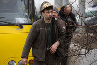 At least 32 miners were killed in a blast at a coal mine in a rebel-held area of east Ukraine Wednesday, the president of Ukraine's parliament said.