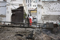 A Somali police official says at least four gunmen have taken positions inside a Mogadishu hotel, where the security forces are trying to regain control.