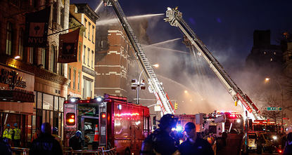Four apartment buildings in New York's East Village neighborhood caught fire from an apparent gas explosion on Thursday and three collapsed, causing 19 injuries, authorities said.  The blast...