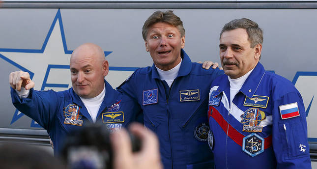 Astronauts blast off for one year trip to space station