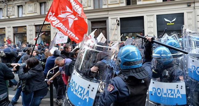 Italian police clash with anti-fascist protesters in Turin