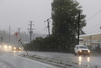 A cyclonic storm lashed Australian state of New South Wales on Tuesday, washing away houses, cutting power to more than 200,000 homes and stranding a cruise ship off the coast in mountainous...