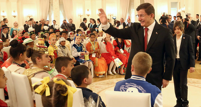PM Davutoğlu receives children from around the world