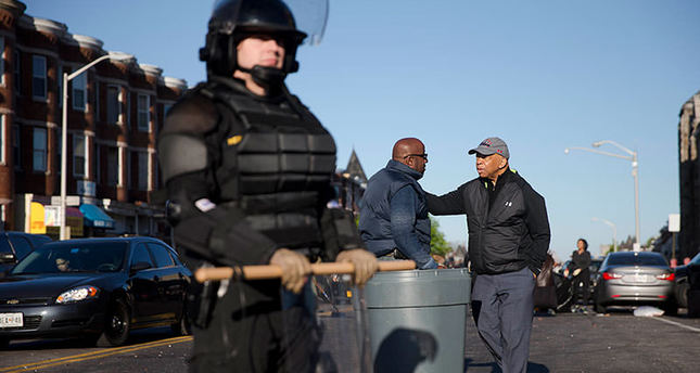 Baltimore hit by violence under state of emergency
