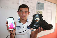 Turkish secondary school student Furkan Faruk Aslan managed to produce nine volts of electricity by walking on boots.