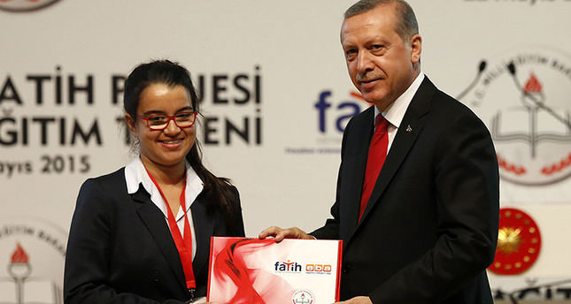 President hands over 700,000 free tablets to students