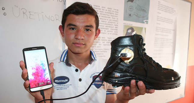 Turkish student invents phone charging boots
