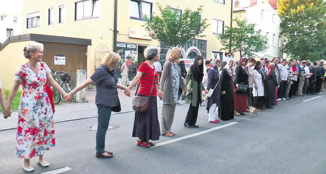 Turks, Germans protest attack on Munich mosque