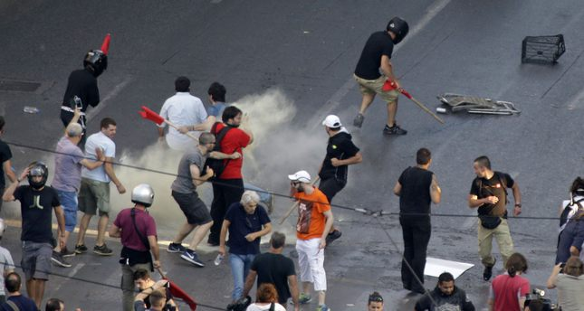 Greek police clash with protesters in Athens