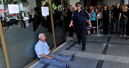 Retiree Giorgos Chatzifotiadis had queued up at three banks in Greece's second city of Thessaloniki on Friday in the hope of withdrawing a pension on behalf of his wife, but all in vain.  When he...