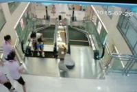 A Chinese woman died after being trapped in a shopping mall escalator, but not before pushing her 2-year-old son to safety.