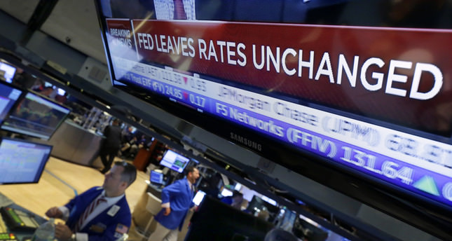 Fed holds rates steady, seeks further economic gains