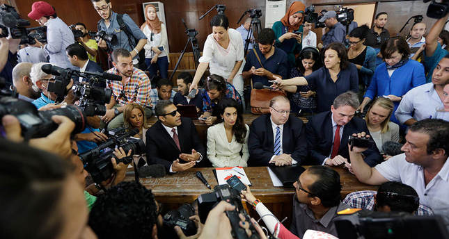 World condemns Egypt on sentencing 3 reporters