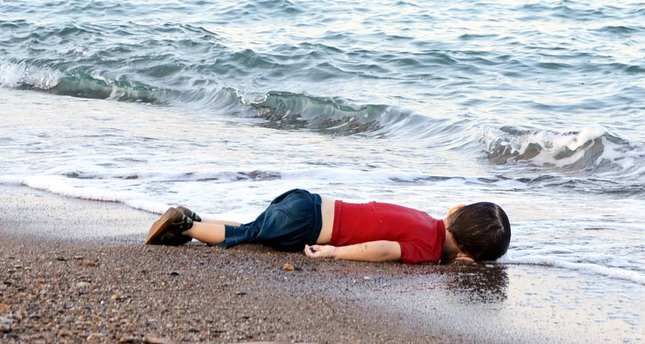 A Syrian boys body washed up on a Turkish shore in a failed attempt to sail to the Greek island of Kos (DHA Photo)
