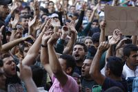 Hundreds of migrants protested in front of Budapest's Keleti Railway Terminus for a second straight day yesterday, shouting