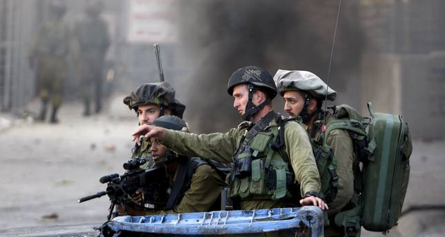 77 Palestinians wounded by live, rubber bullets