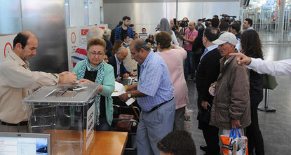 Turkish citizens living abroad have started casting their ballots at airports and customs gates, almost a month before the election date in Turkey, which will take place on November 1.