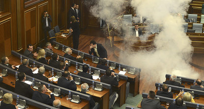 Kosovo opposition deputies threw tear gas canisters in Parliament on Thursday to protest the latest EU-brokered agreements between Kosovo and Serbia.