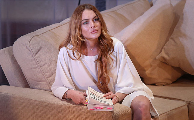 In this  Sept. 30, 2014 file photo, U.S actress Lindsay Lohan performs a scene from the play, Speed the Plow, during a photocall at the Playhouse Theatre in central London. (AP Photo)