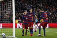 Lionel Messi scored his first two goals after a two-month injury layoff and Luis Suarez netted a brace in a 6-1 rout of Roma on Tuesday as Barcelona advanced to the Champions League knockout rounds...