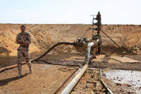 A member of the Syrian army ınspects the jazal oil field after fierce battles with Daesh.