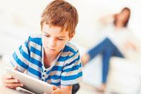 Tablet computers and smartphones given to children so their elders can have a peaceful dinner with friends has been cited as causing a decline in communication between parents and their children as...