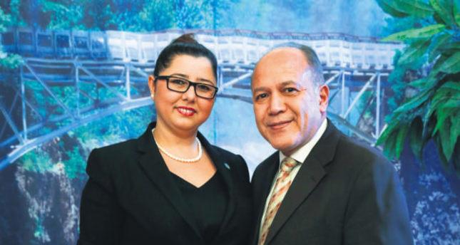 Derya Taşkın (L) poses with Mayor Jose Torres.