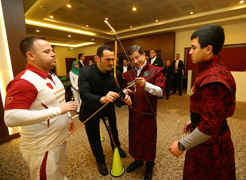 Davutoğlu takes 'bow and arrow' break at AK Party retreat