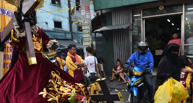 Hundreds of thousands of barefoot devotees attend the annual religious procession in Manila in one of the worlds biggest Catholic parades honoring an ebony statue of Jesus Christ they believe has miraculous powers.