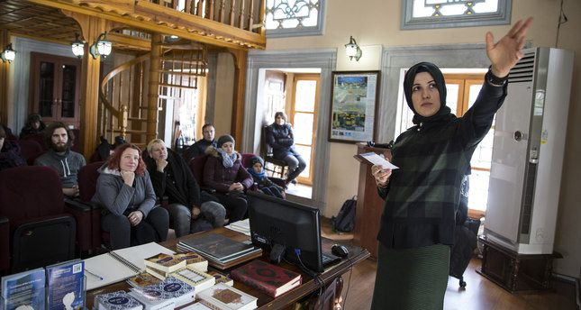 Female mosque guide introduces Islam to foreign tourists