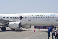 A Somali official says that a bomb blew a hole in a jetliner, killing one person and forcing the plane to make an emergency landing in Somalia's capital, Mogadishu, on Tuesday.