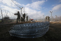 Macedonia has begun building a new razor-wire fence parallel to an existing one on its border with Greece to make it harder for illegal migrants to enter the Balkan country, an army official said...