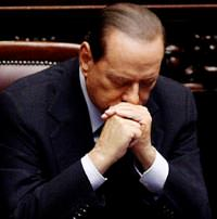 Berlusconi faces crunch vote, pressure to quit