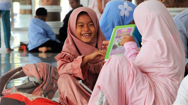 AÇE'de camileri dolduran çocuklar cemaate neşe katıyor
